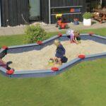 8 tals sandkasse med 10 kanter. her er der mulighed for at flere børn kan lege sammen på samme tid, uden at genere hinanden.
